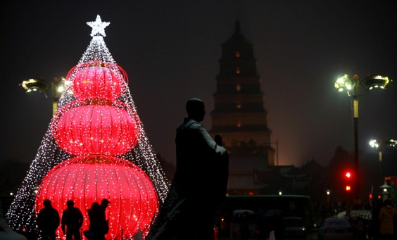 Image: A Christmas tree installed with lanterns, measuring over 10 meters high, is illuminated in Shaanxi Province, China