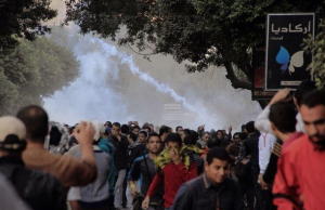 """Protesters run after police fired tear gas in Cairo, Dec. 6, 2013"" By Hamada Elrasam for VOA"