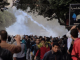 """""""Protesters run after police fired tear gas in Cairo, Dec. 6, 2013"""" By Hamada Elrasam for VOA"""